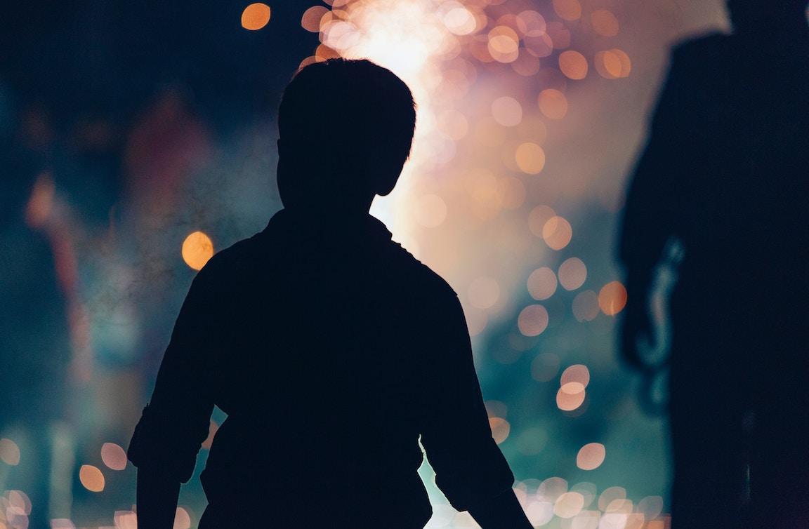 Silhouette of little boy.